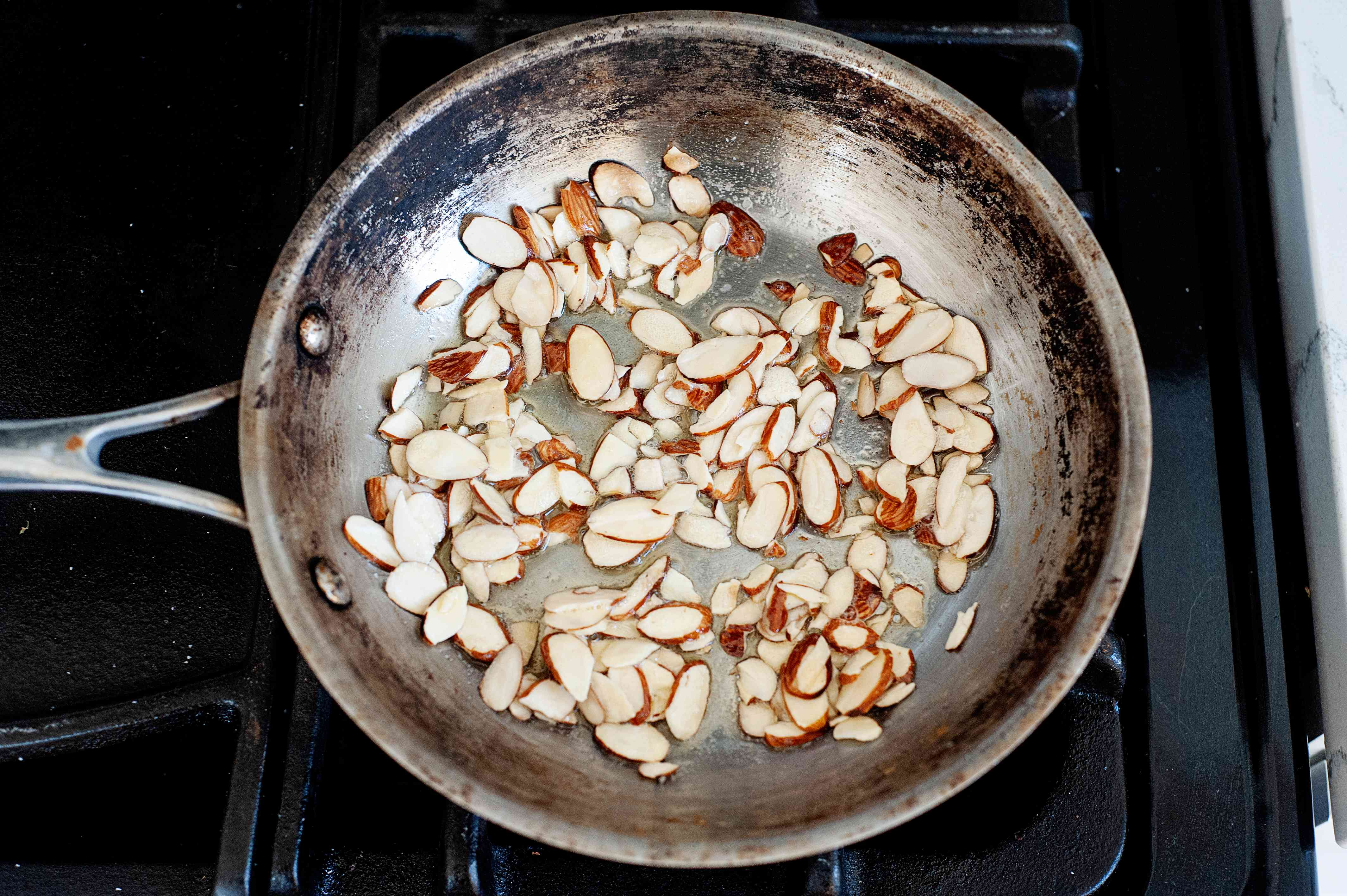 Toasting almonds for a Crisp and Refreshing Green Spring Salad