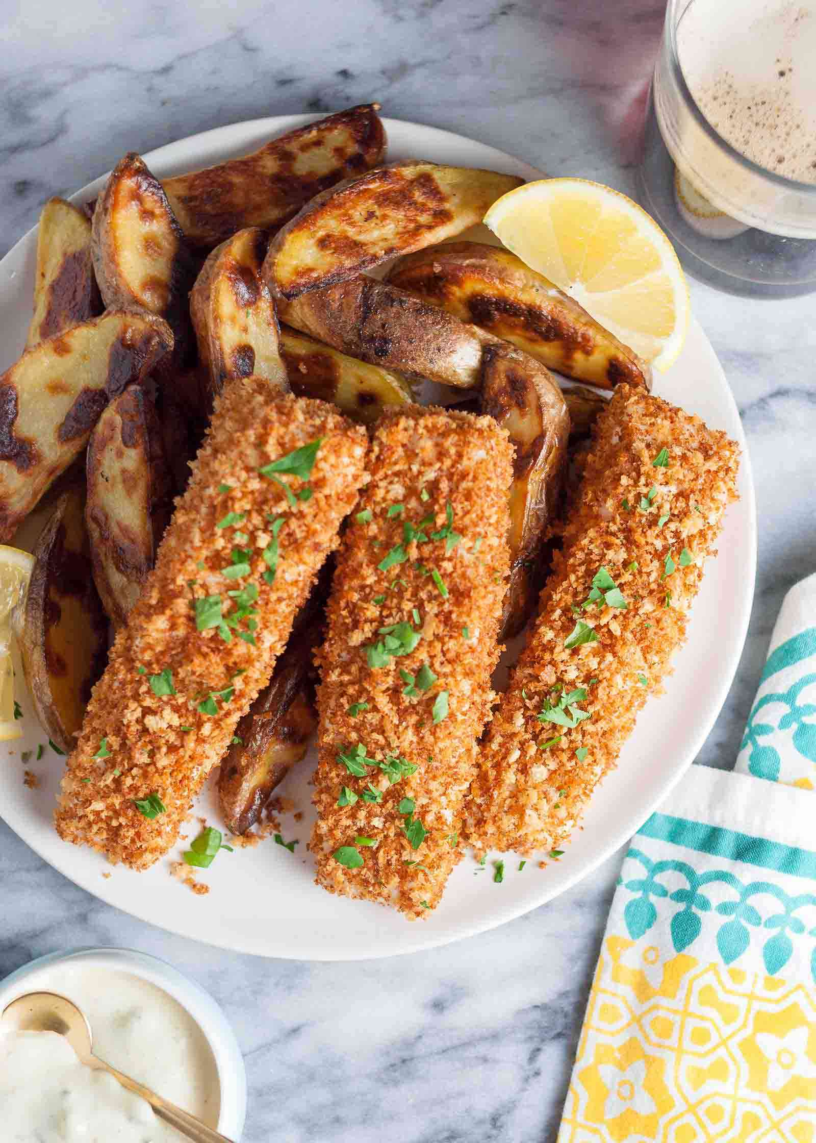 Baked Fish and Chips on Plate with Lemon Wedge