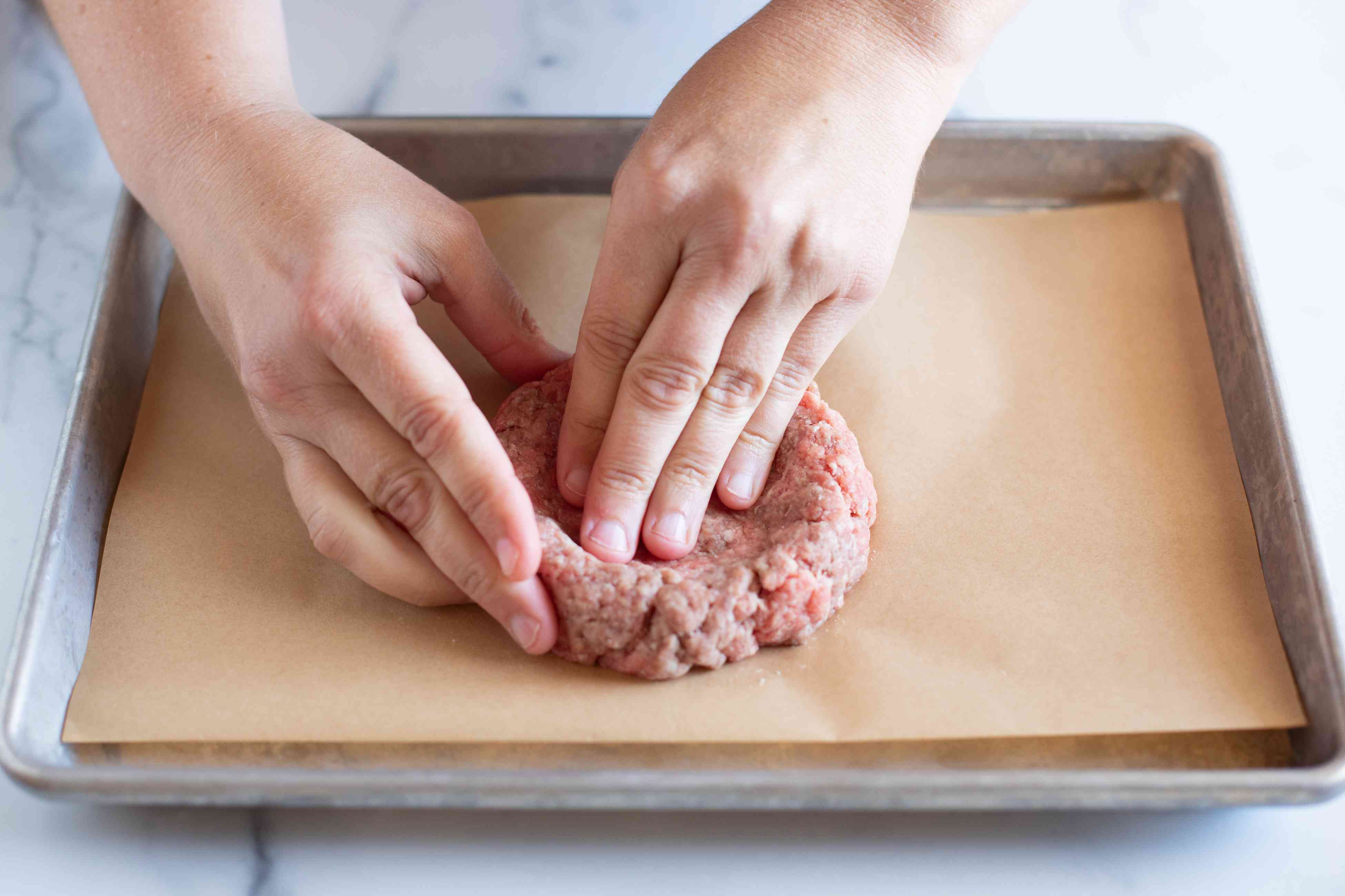 How to shape burger patties using hands and pressing.