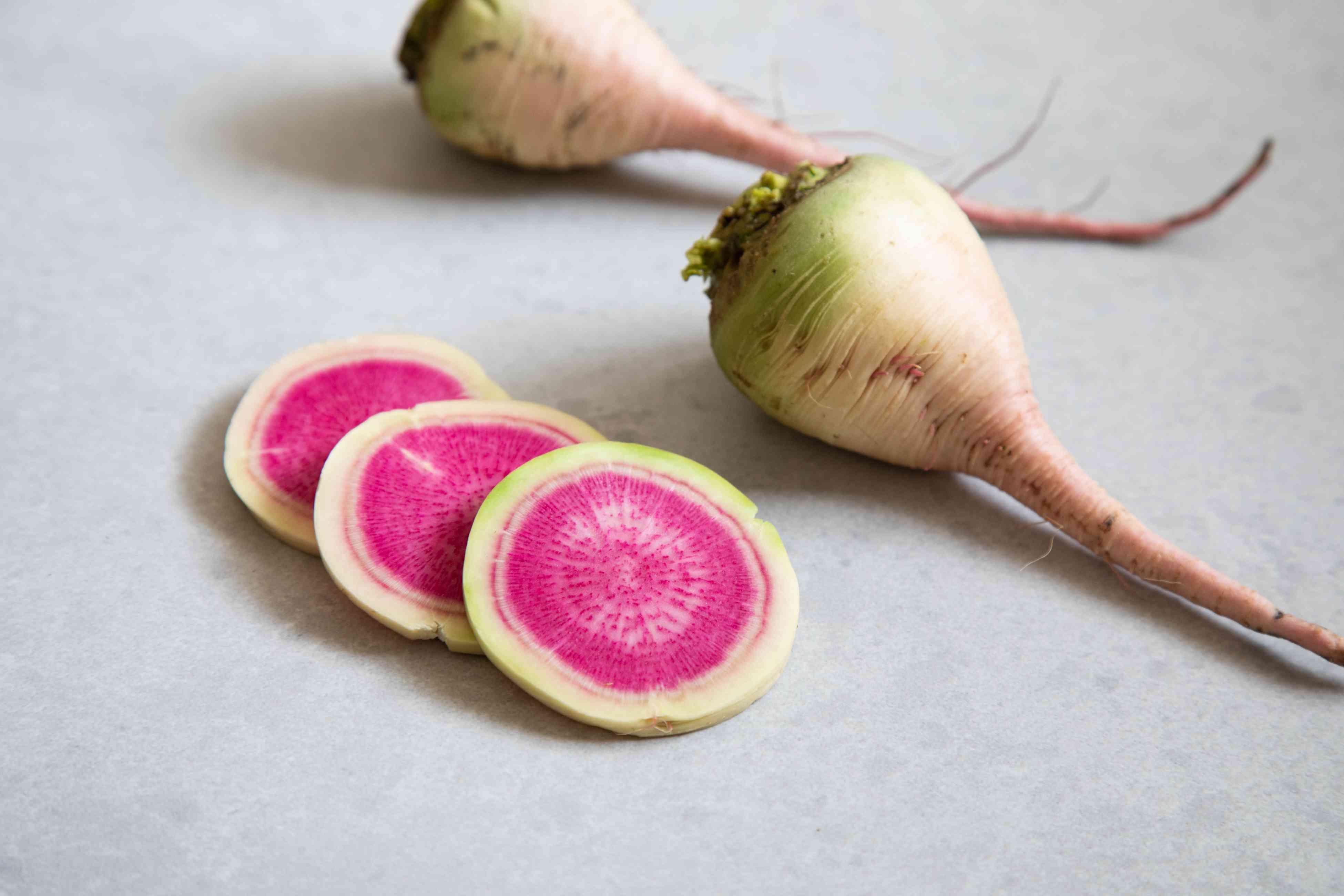 Sliced and whole watermelon radish