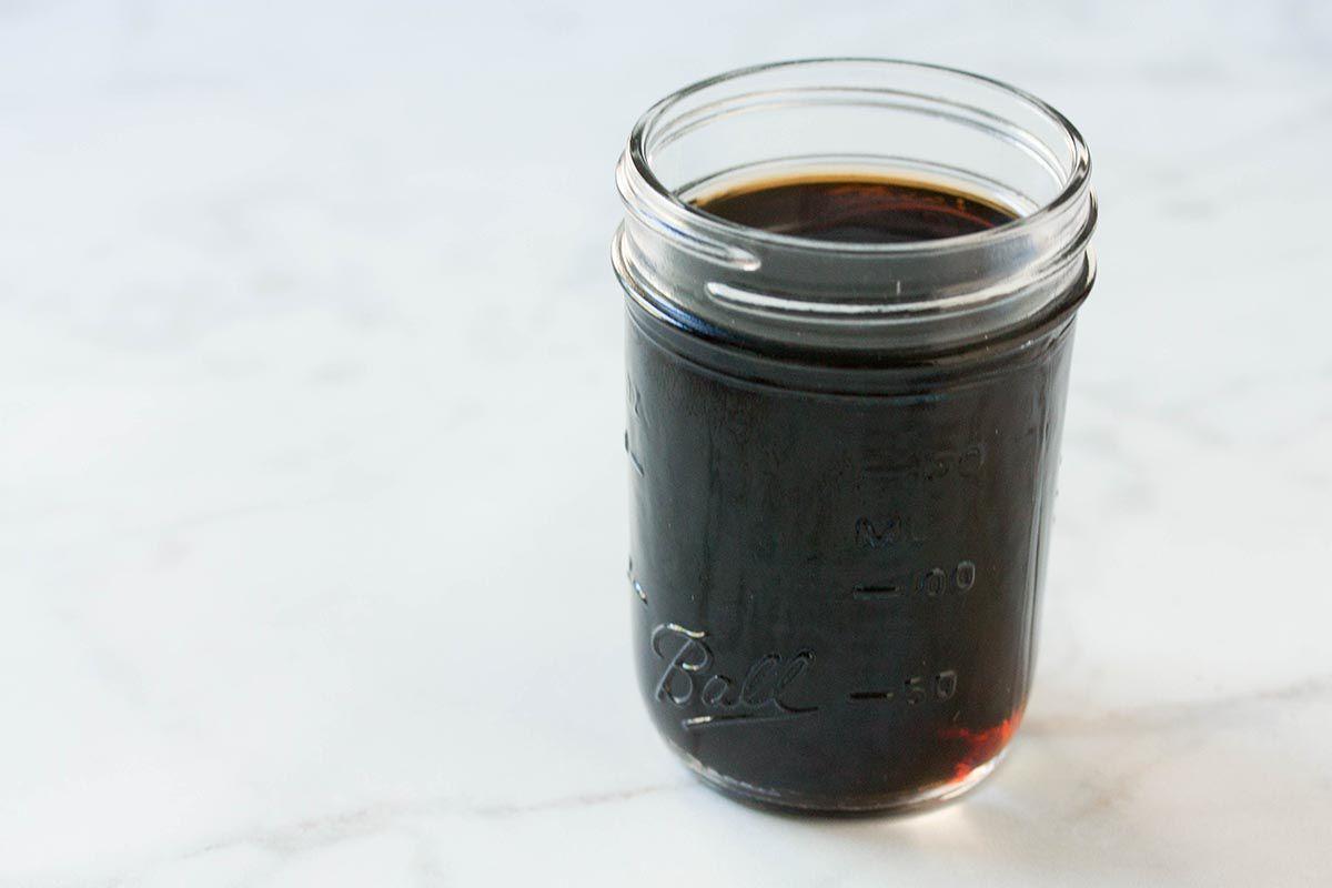Irish Coffee in small mason jar on granite table
