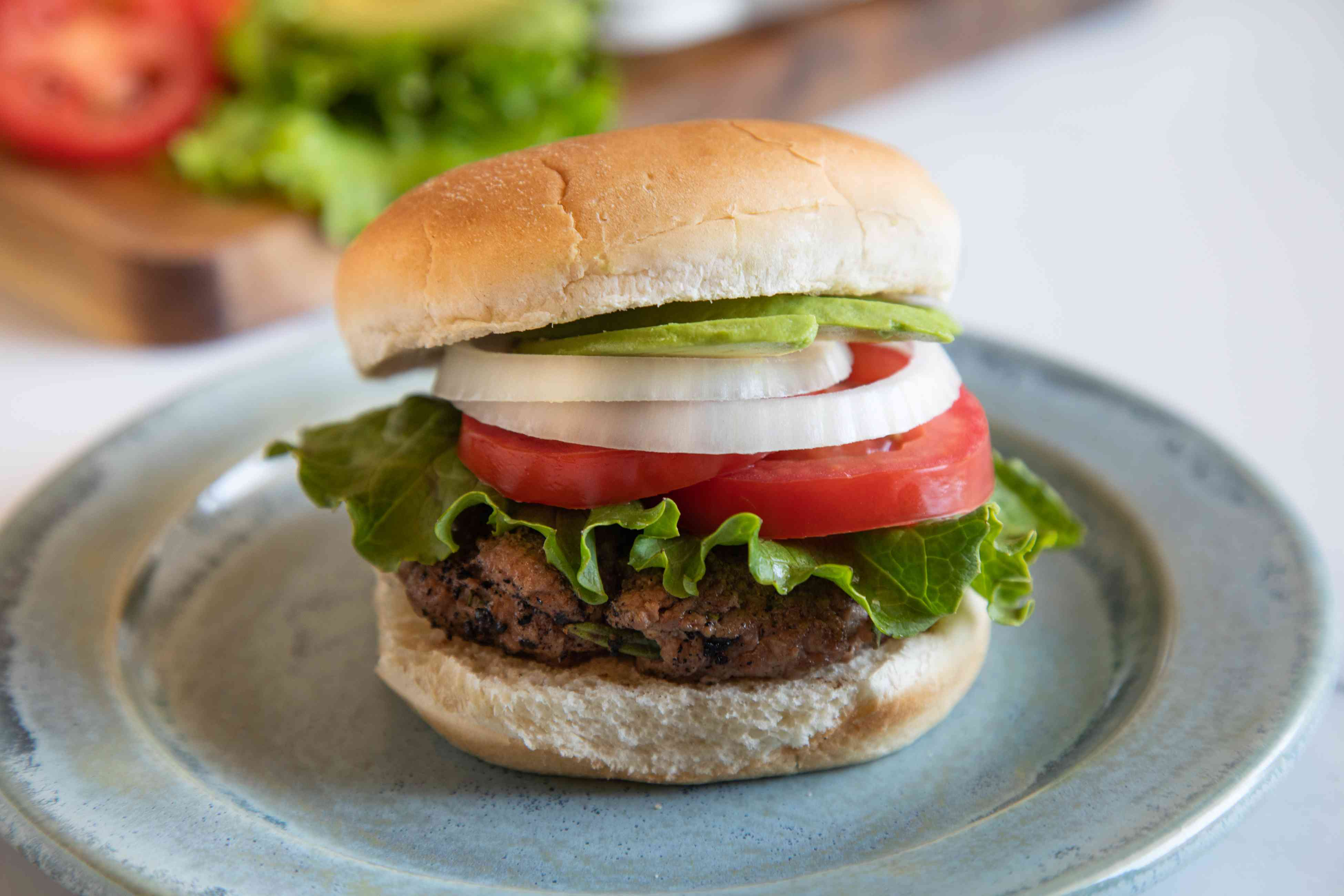 Side view of a hamburger with toppings.