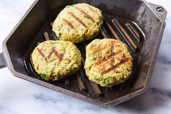 Three patties in a grill pan to show tips to make a great veggie burger.
