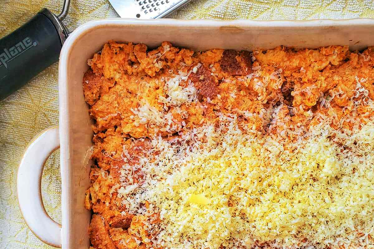 Grated cheese sprinkled over a Savory Pumpkin Egg Bake.