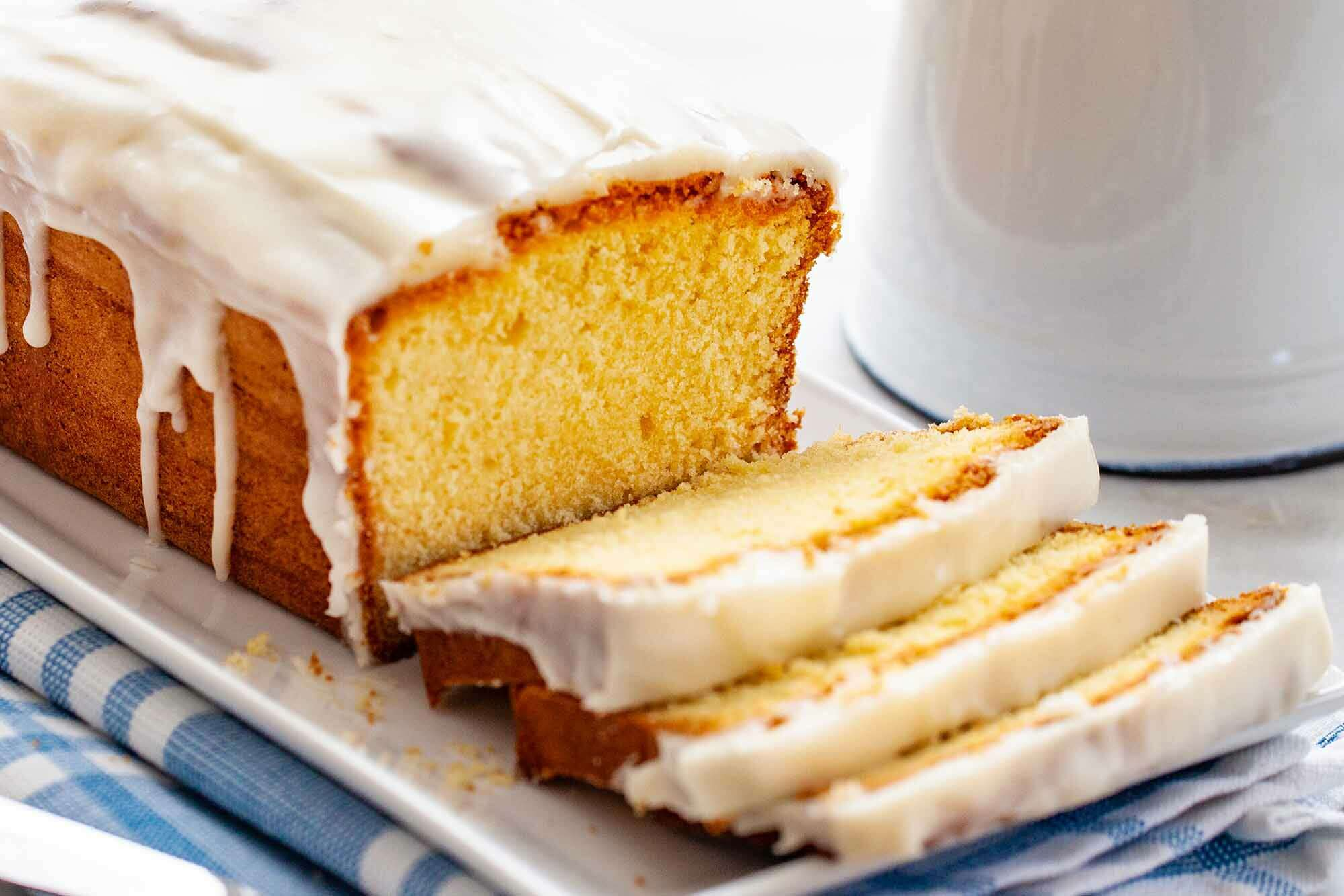 Vanilla Pound Cake sliced on a plate with icing
