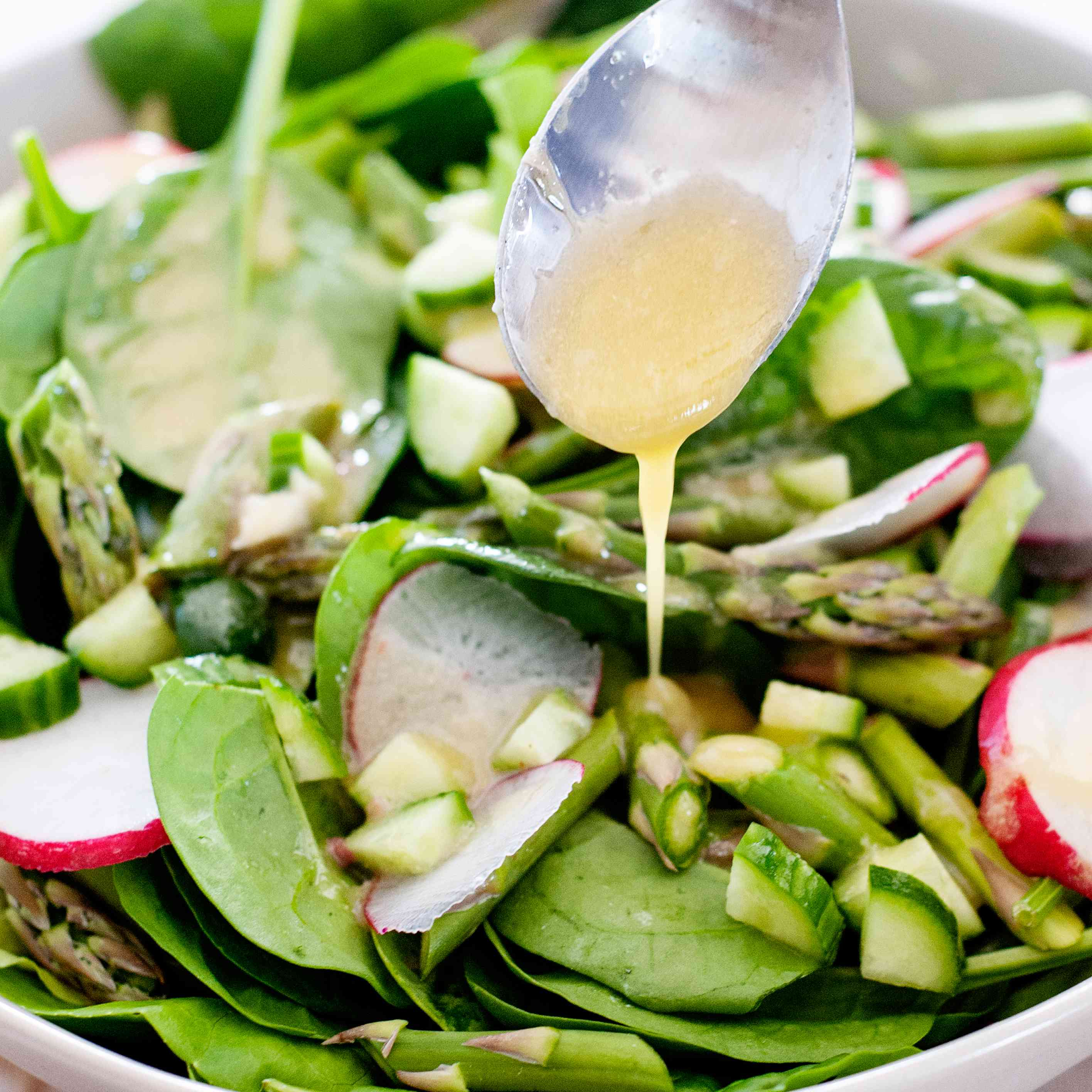 Easy Anchovy Salad Dressing spooned on a salad.