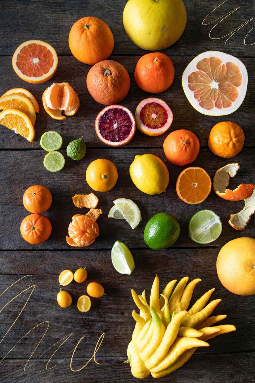 Citrus varieties on dark wood background