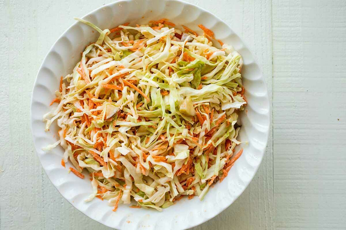 Shredded carrots and cabbage in a bowl to make pickle slaw for easy BBQ Chicken Sandwiches.
