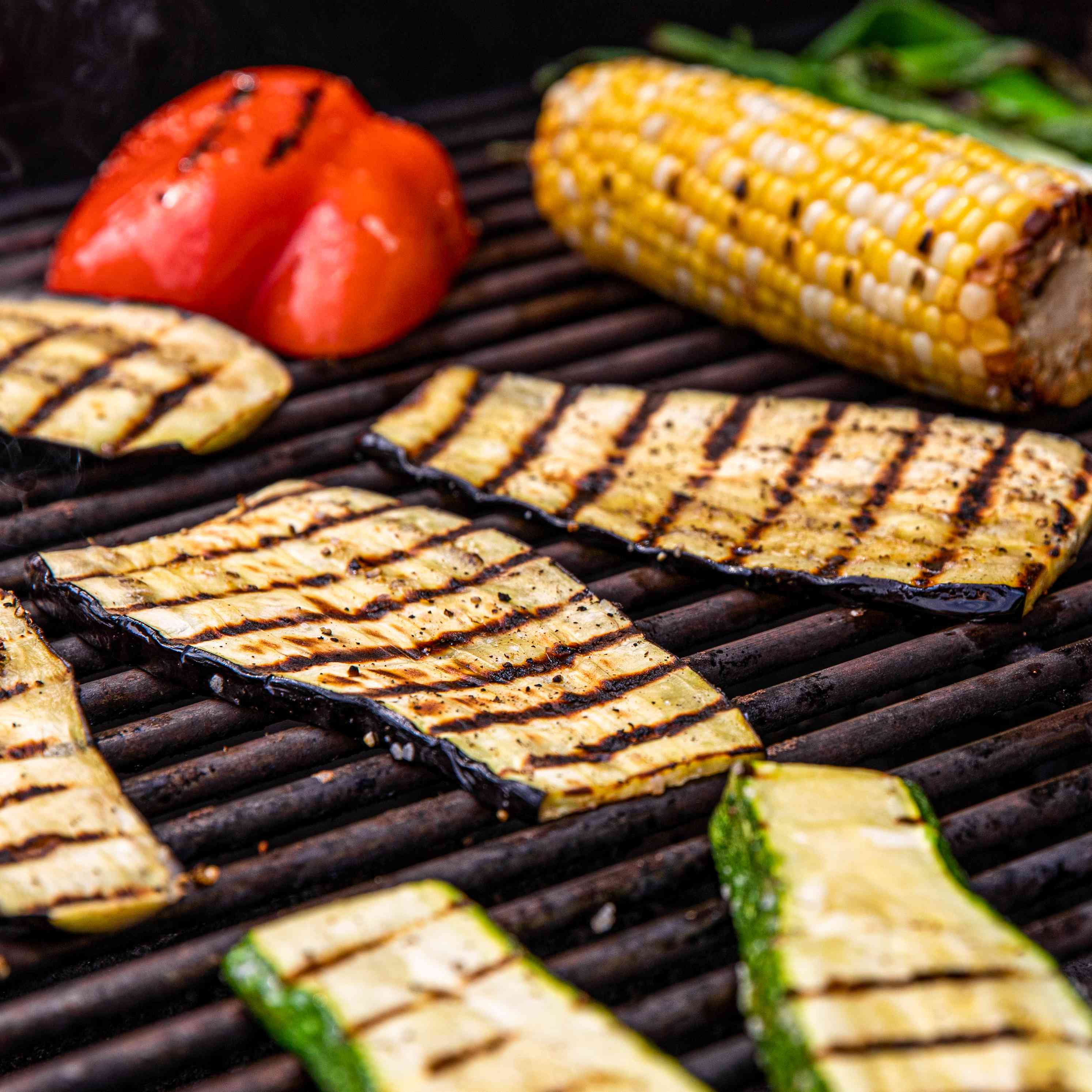Sliced zucchini on the grill to make grilled summer vegetable nachos.