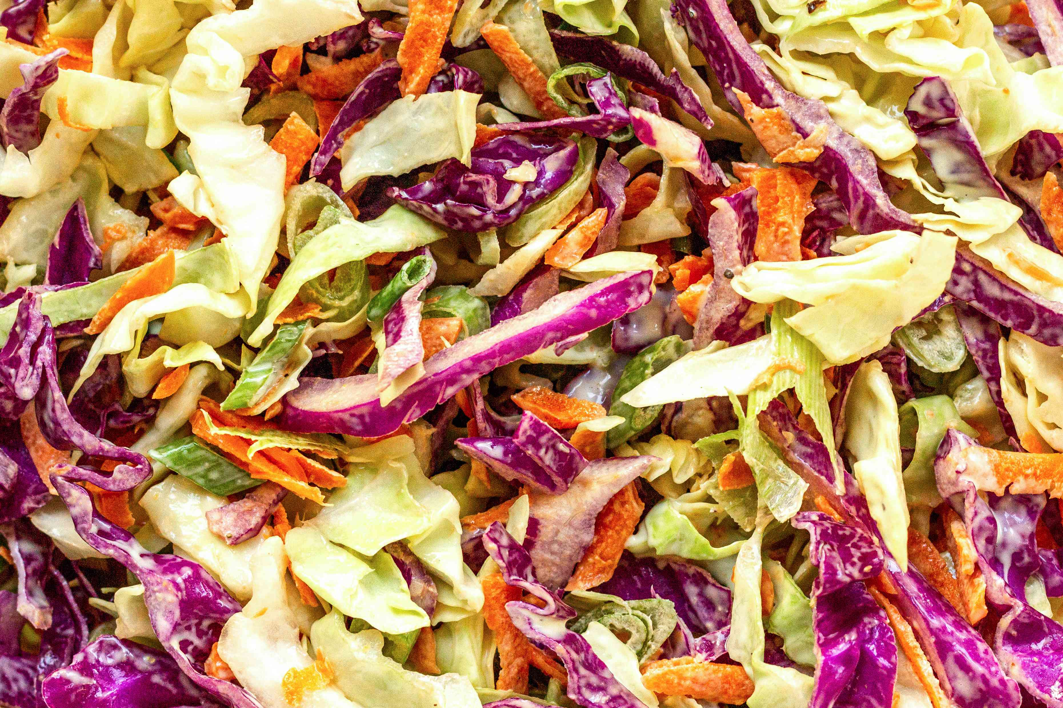 Sliced cabbage and carrots mixed to make Classic Coleslaw.