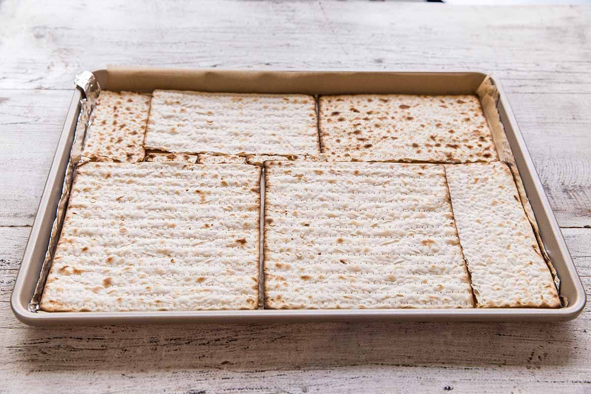 Chocolate Toffee Matzo Crack - baking sheet with matzo crackers in a single layer