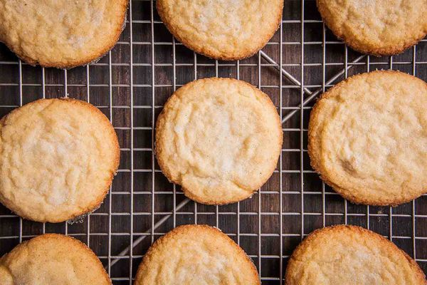 Soft and Chewy Sugar Cookies on Mesh Baking sheet