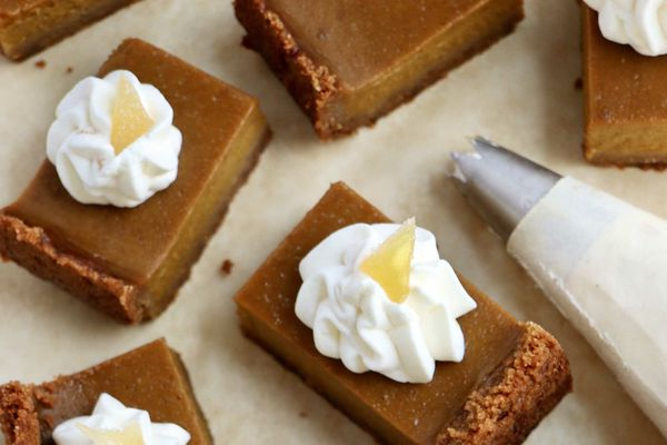 Sliced Pumpkin Pie Squares topped with whipped cream.