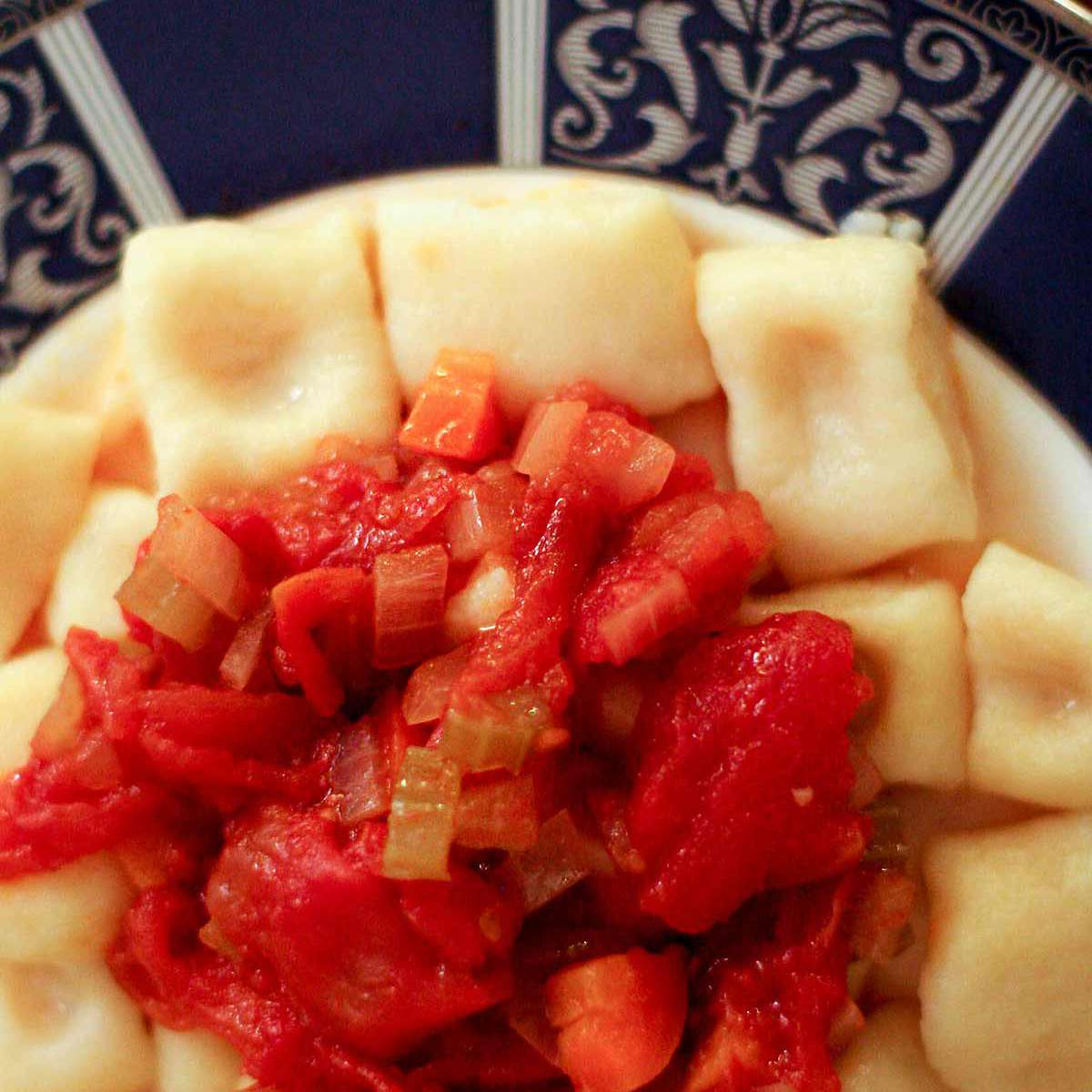 Dish of Potato Gnocchi with red sauce