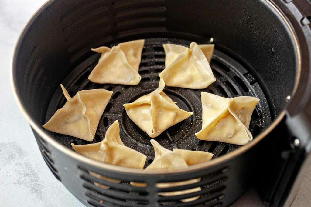 Cream cheese wontons placed in the air fryer