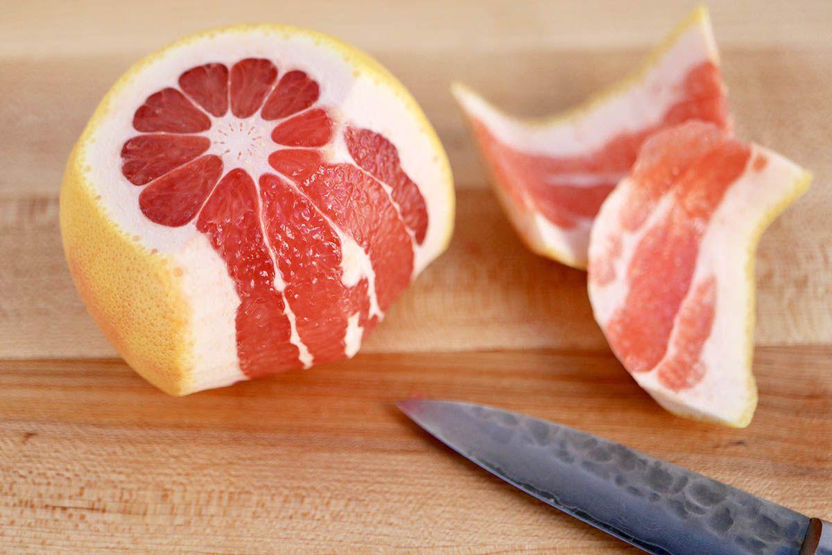 Orange being cut for Citrus Parfait