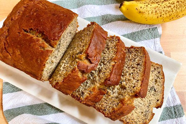 Overhead view of simple gluten-free banana bread on a platter and sliced into thick slices.