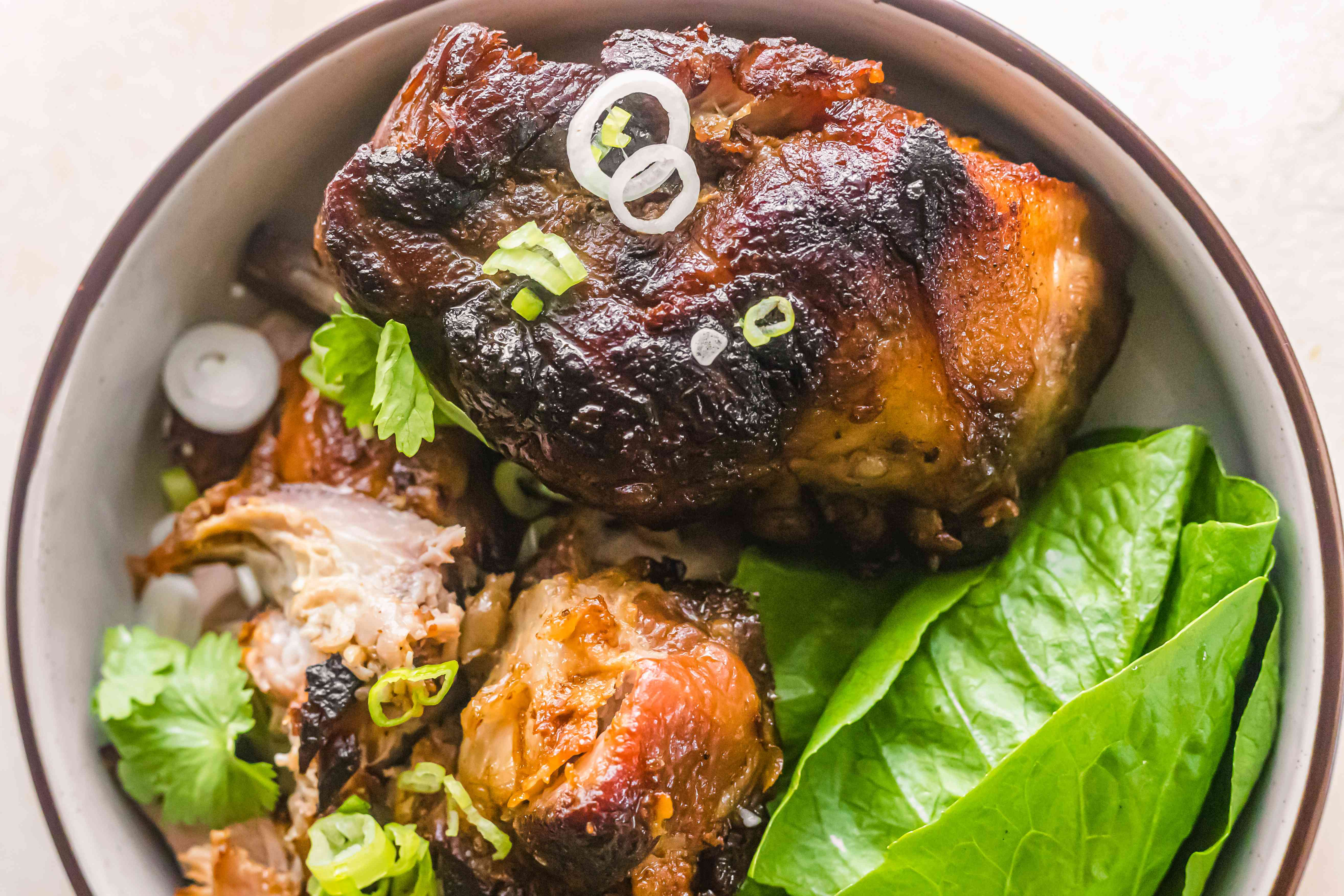 Roasted hunk of meat in a dutch oven with lettuce