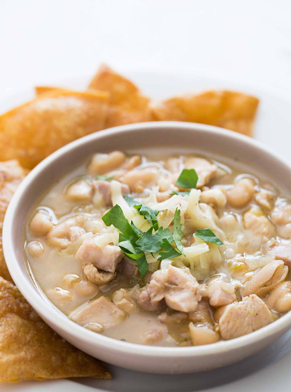 Best White chicken chili in a white serving bowl with chips