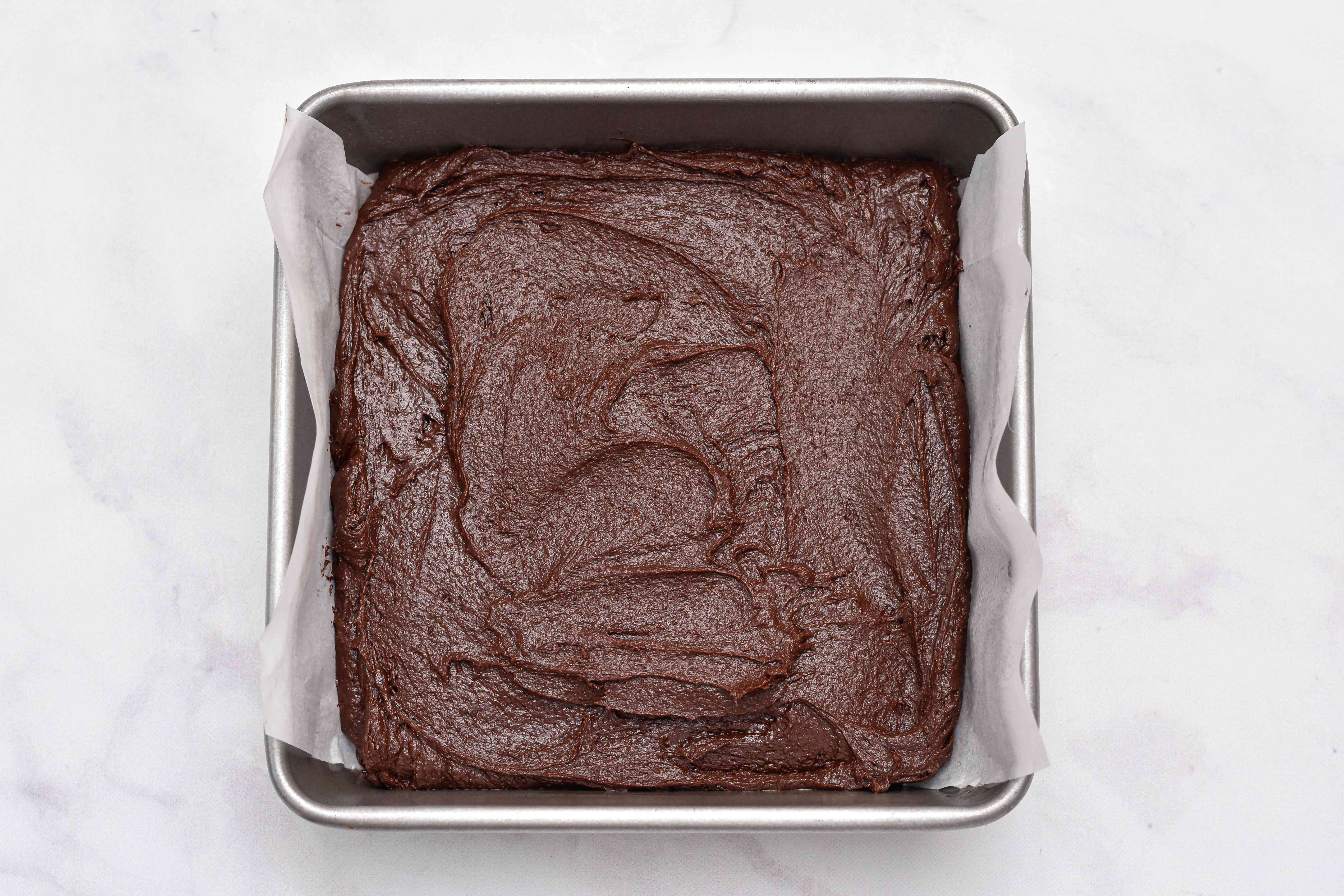 Brownie batter in pan to make Salted Caramel Brownies
