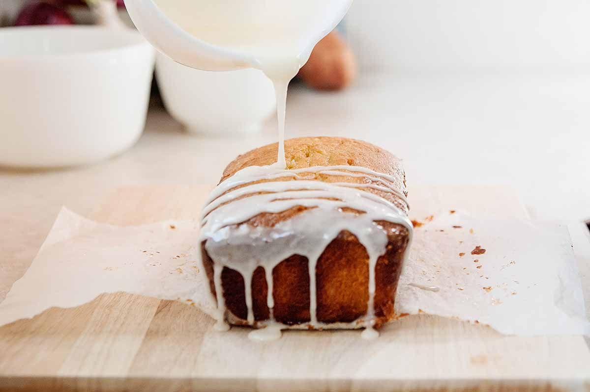Starbucks Lemon Pound Cake Recipe - lemon icing being poured over lemon pound cake