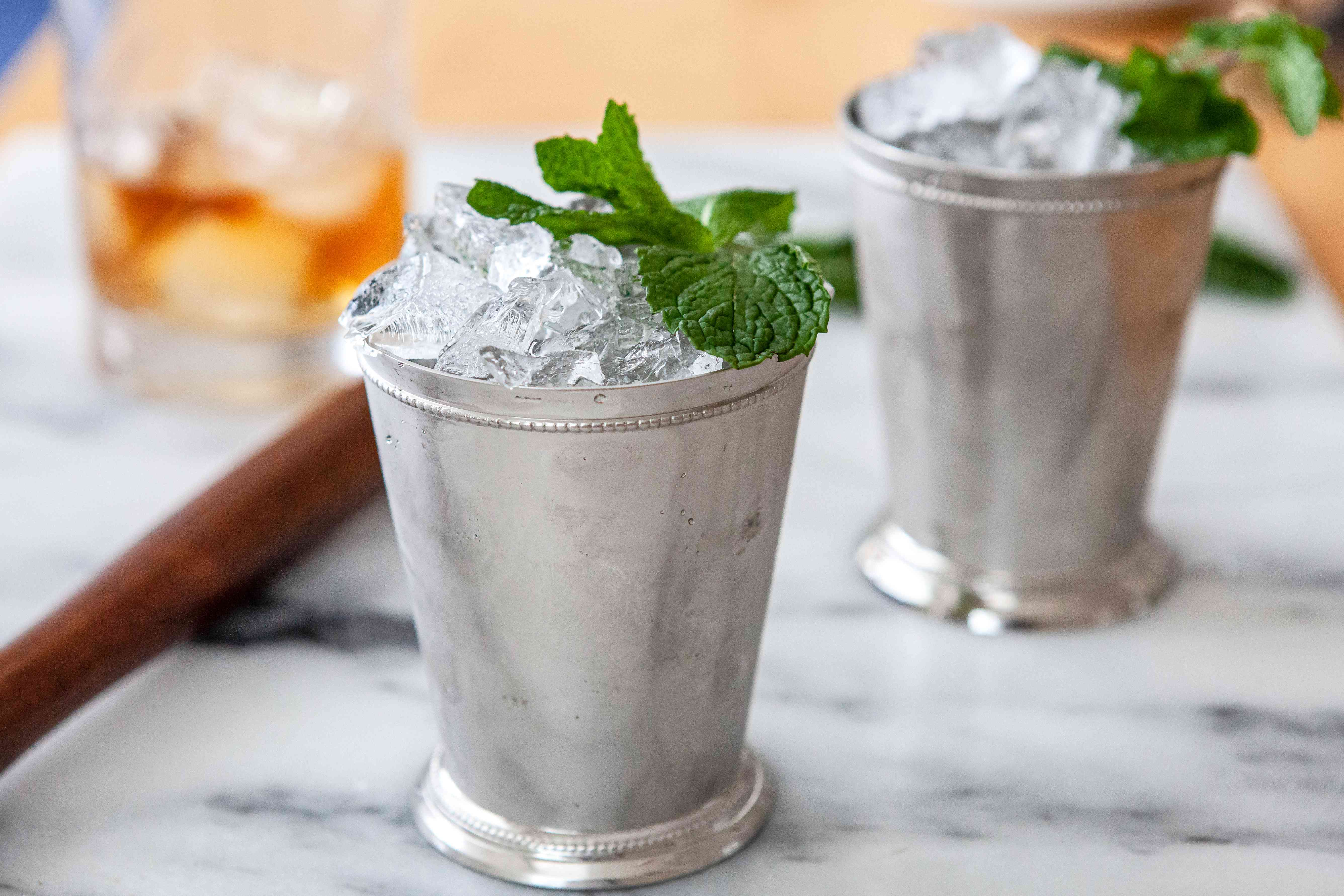 Two Mint Julep Cocktails topped with mint.