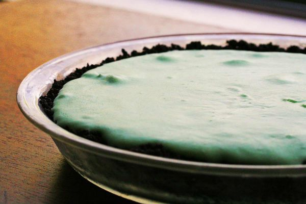 Chilled Grasshopper Pie on Wood Table