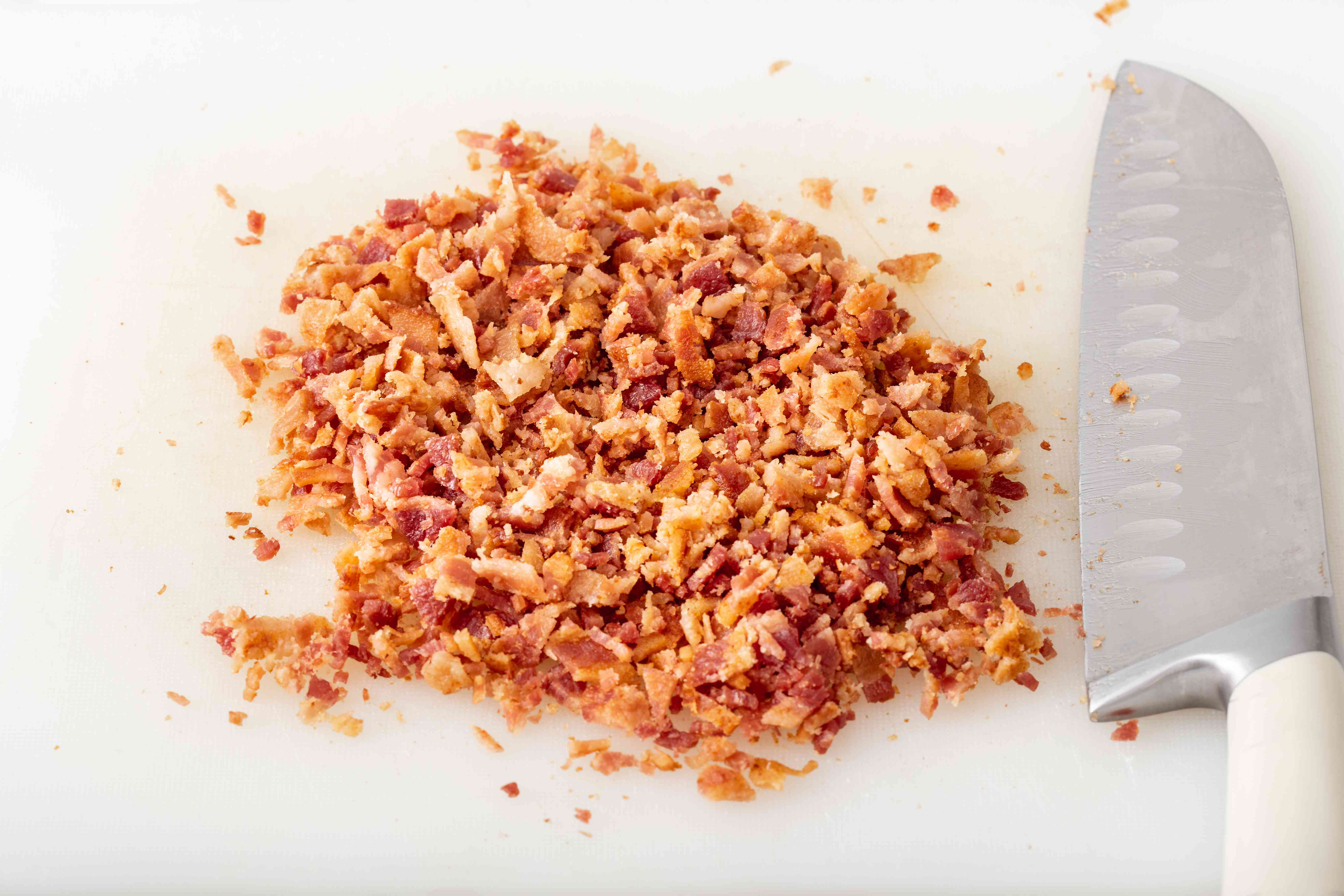 Chopped bacon on a cutting board to make the best potato salad recipe.