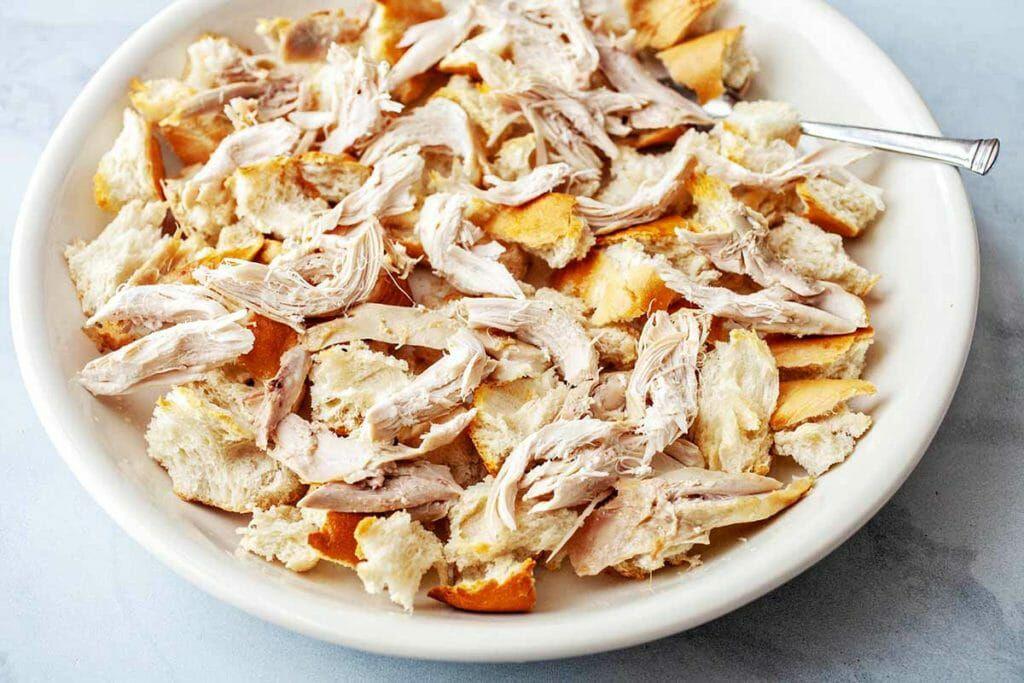 Chicken Panzanella Salad - chicken and bread in white bowl