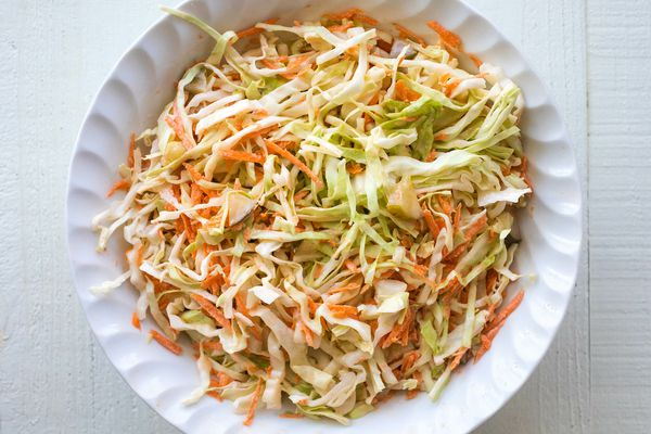 Pickle slaw with cabbage, carrots, and pickle juice in a bowl