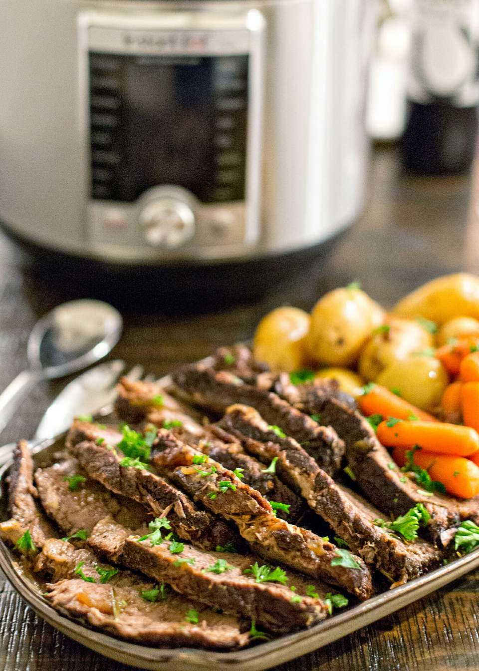 Sliced roast beef, cooked carrots, and cooked potatoes for instant pot pot roast