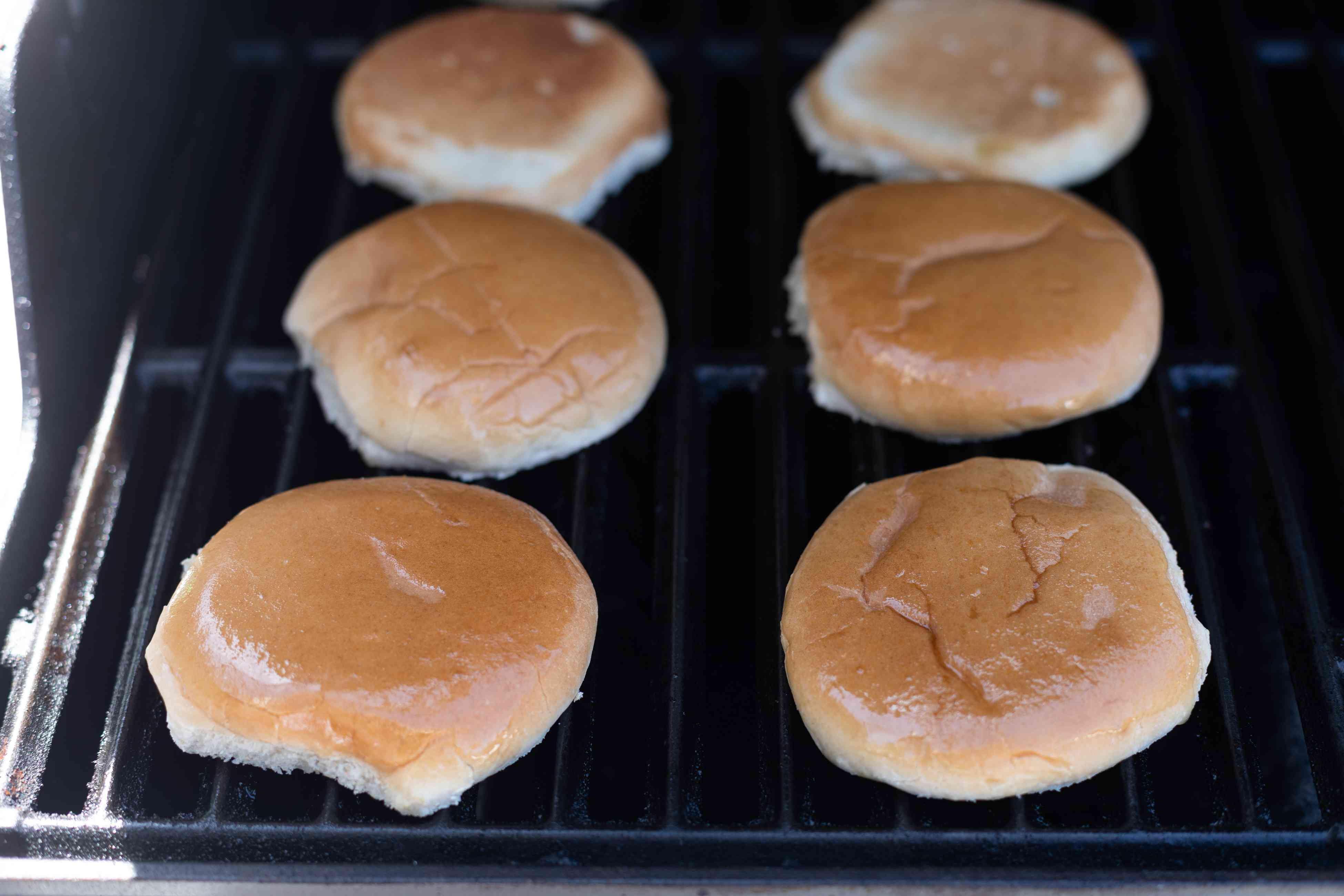 Toasting buns on the grill for mushroom swiss burgers.