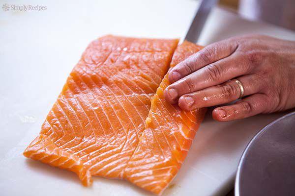 filleting the salmon on cutting board