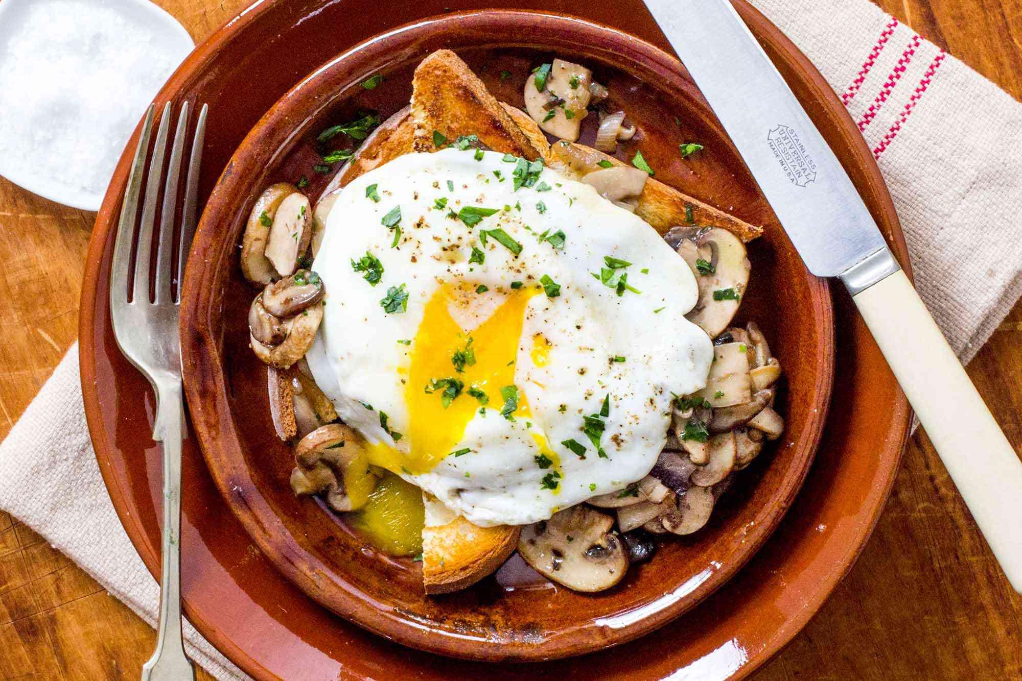 Mushrooms on toast with egg