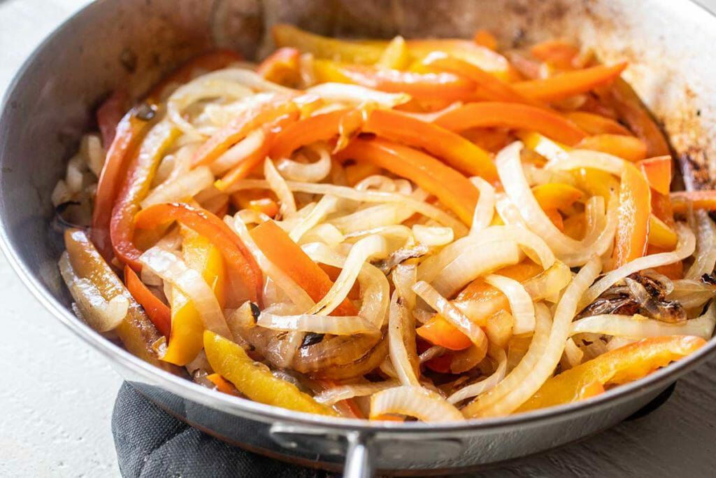 Cook the onions and peppers for chicken freezer burritos