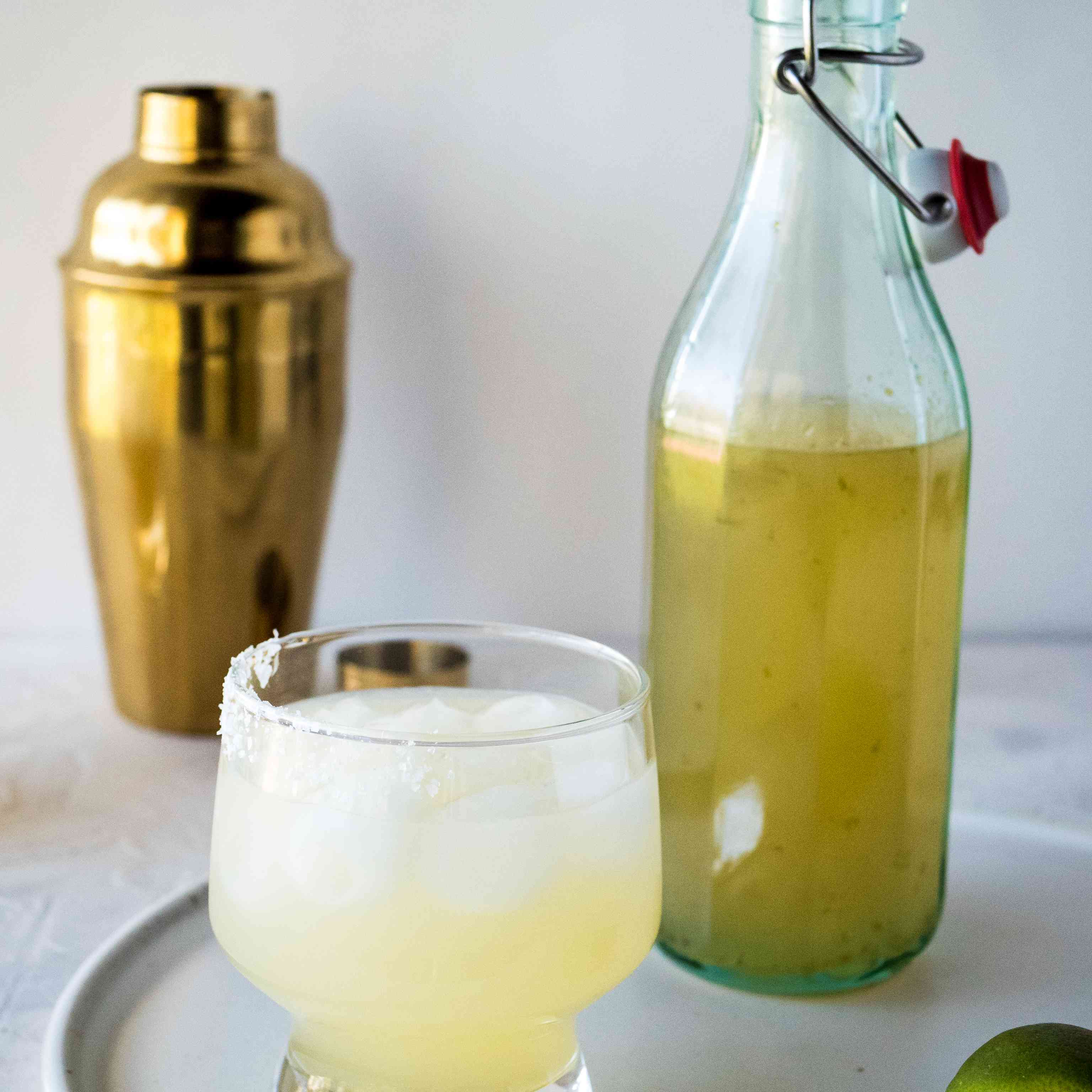 A margarita in a glass with homemade margarita mix.