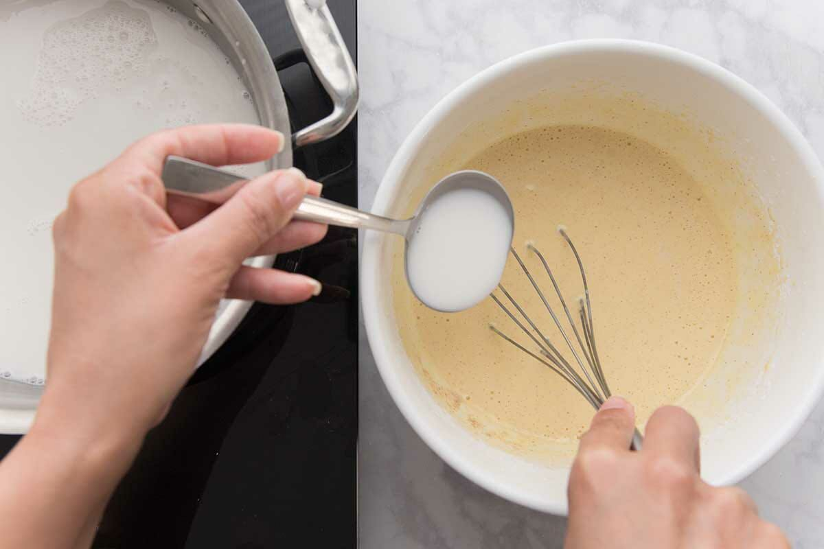 How to make coconut cream pie by slowly adding the warm milk to the egg mixture for the filling.