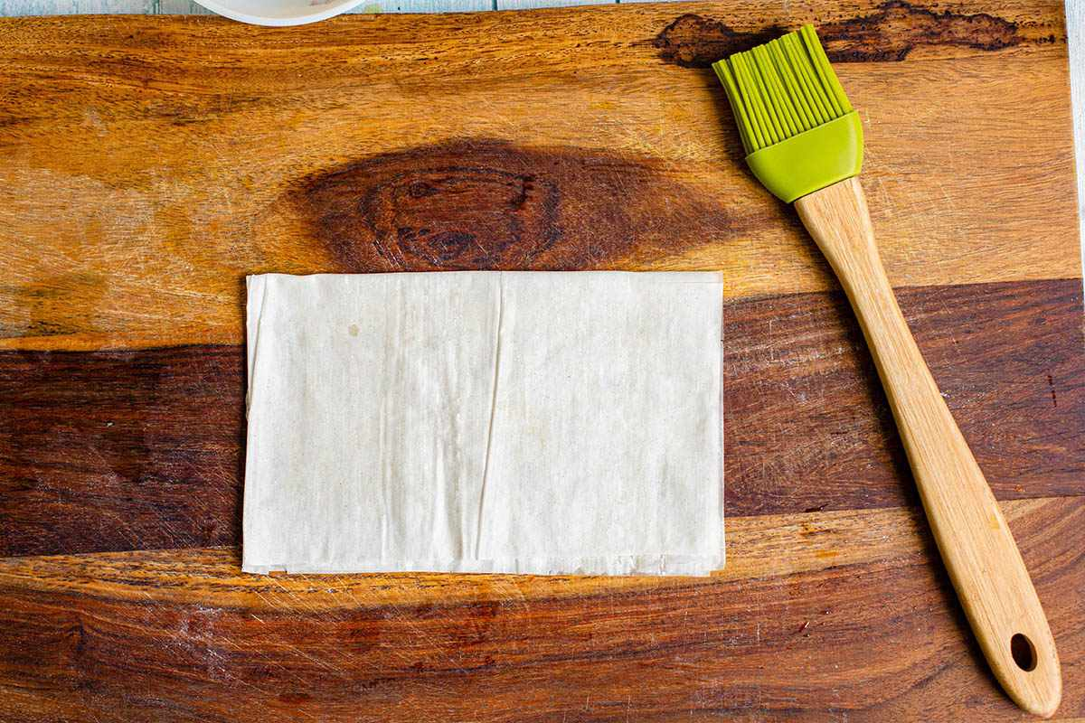 Phyllo dough brushed with butter for chicken tikka masala samosas