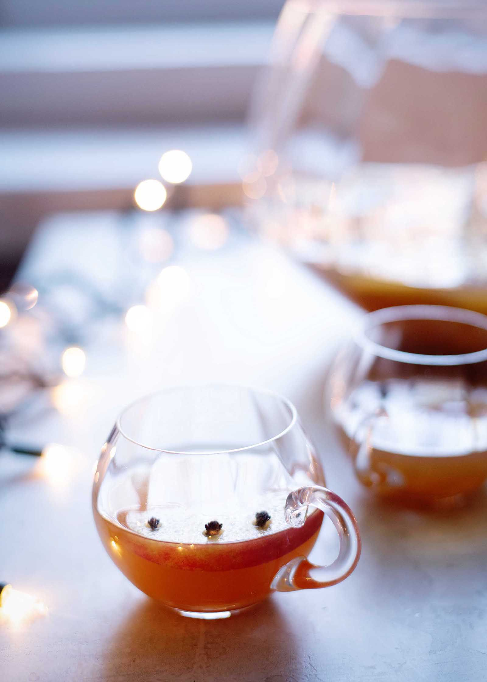 Mugs of apple cider brandy punch with chai spice