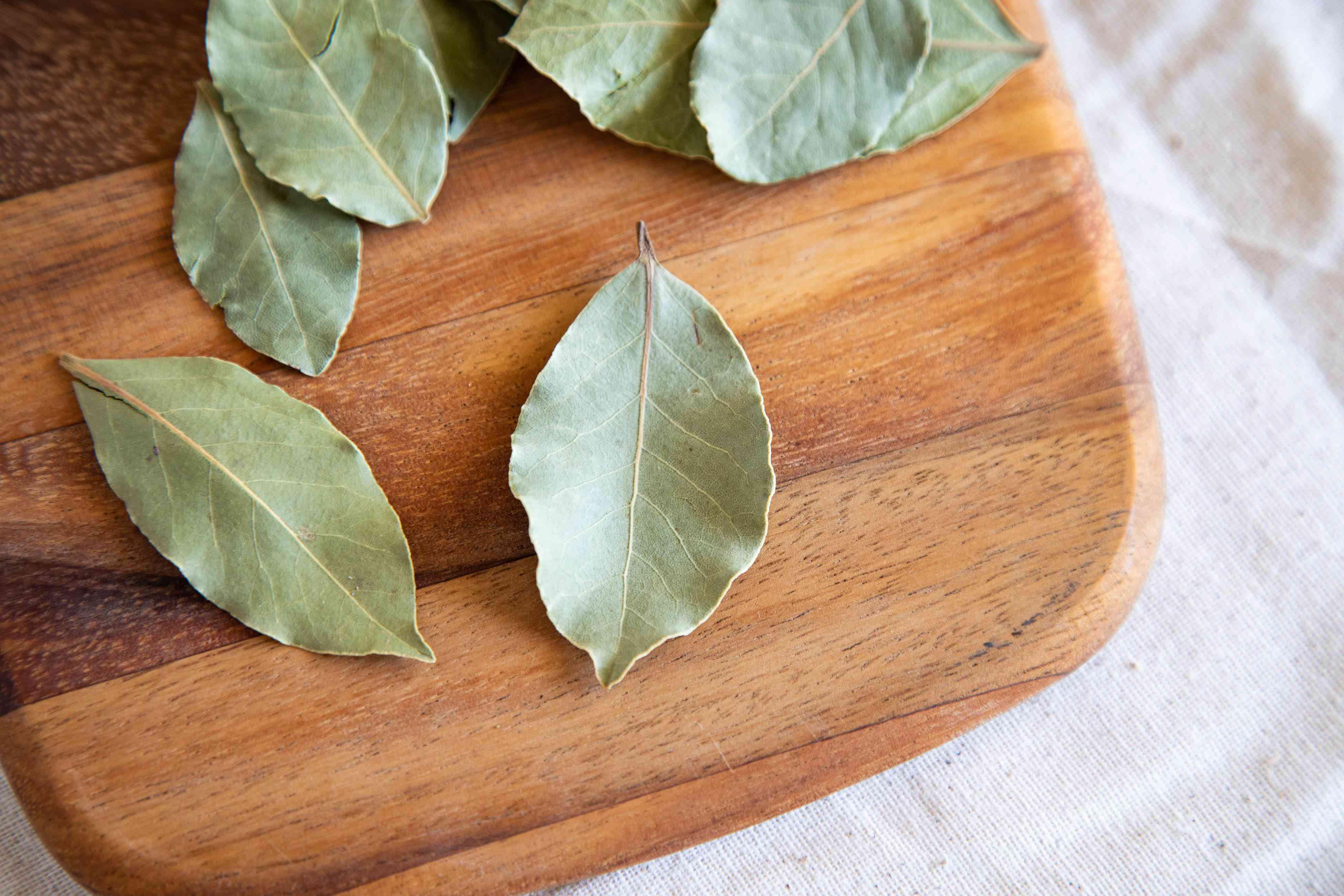 Close up bay leaf on wood cutting board