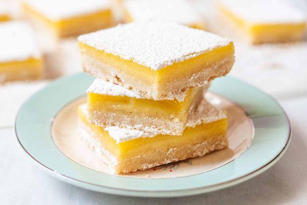 Lemon Bars Recipe - lemon bars on blue plate
