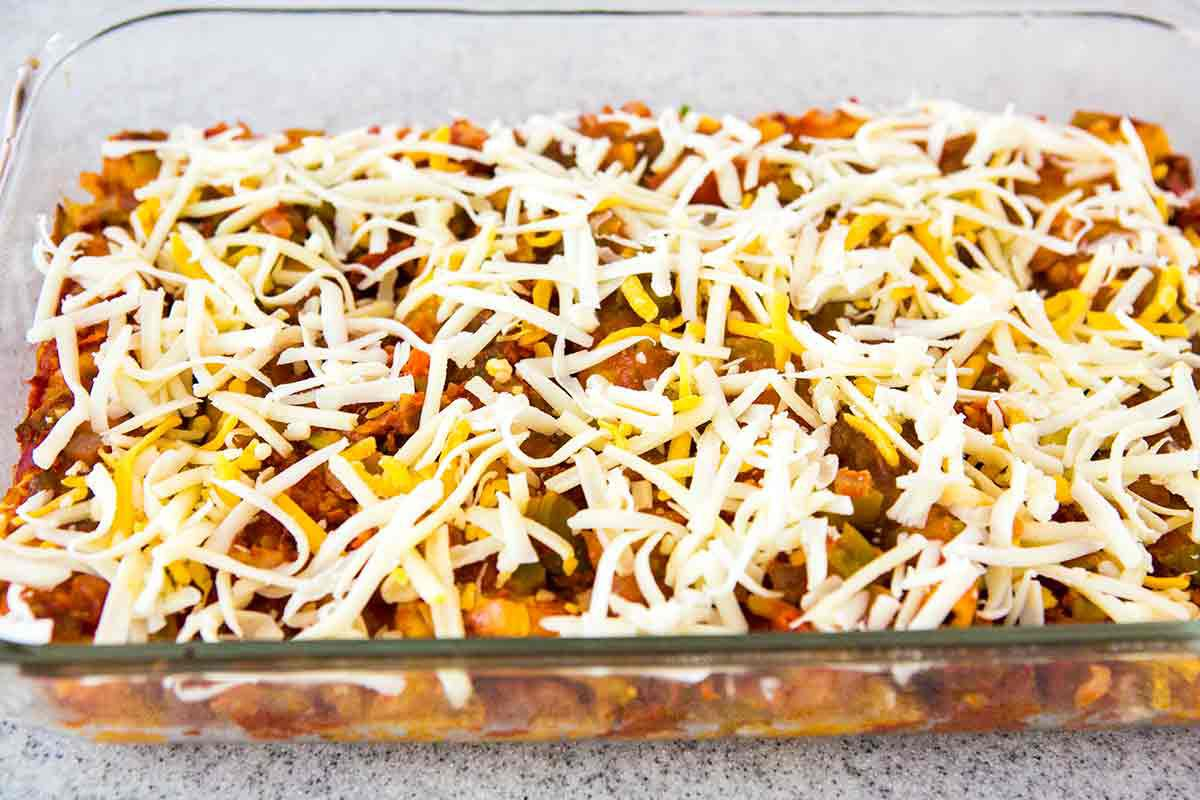 sprinkle enchiladas with cheese