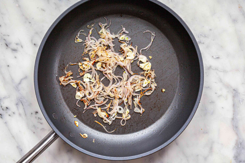 Sauteed red onion to make Mexican Enfrijoladas.