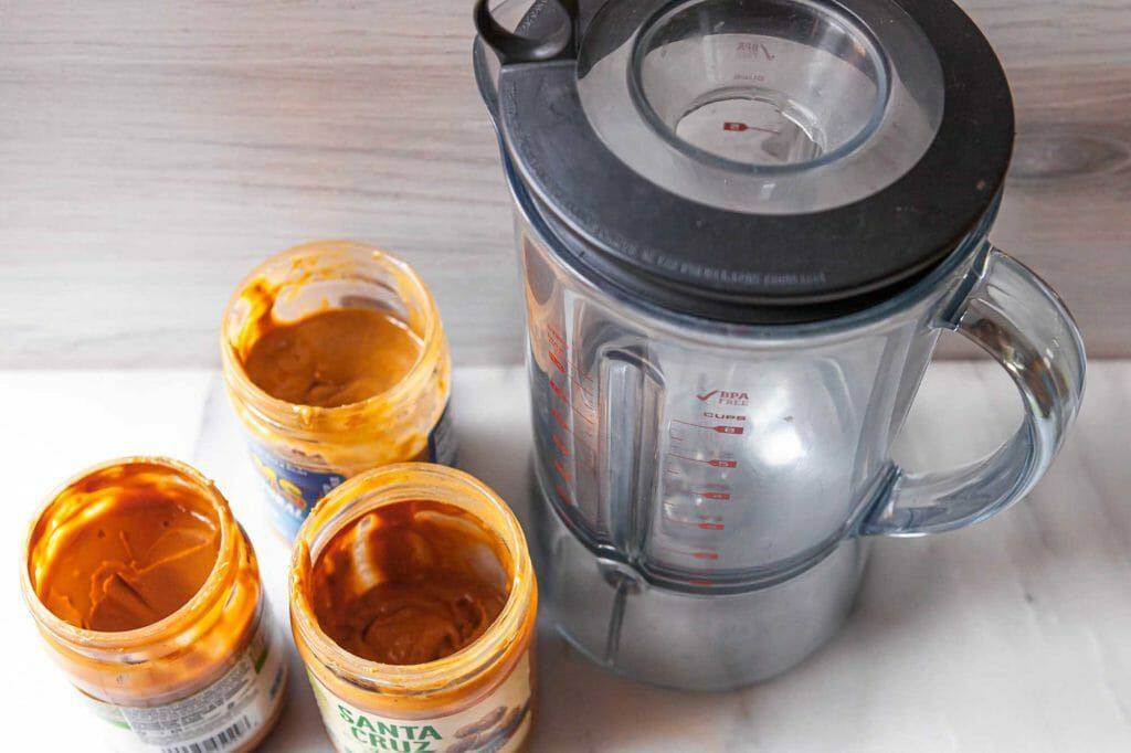 Blending natural peanut butter in a blender