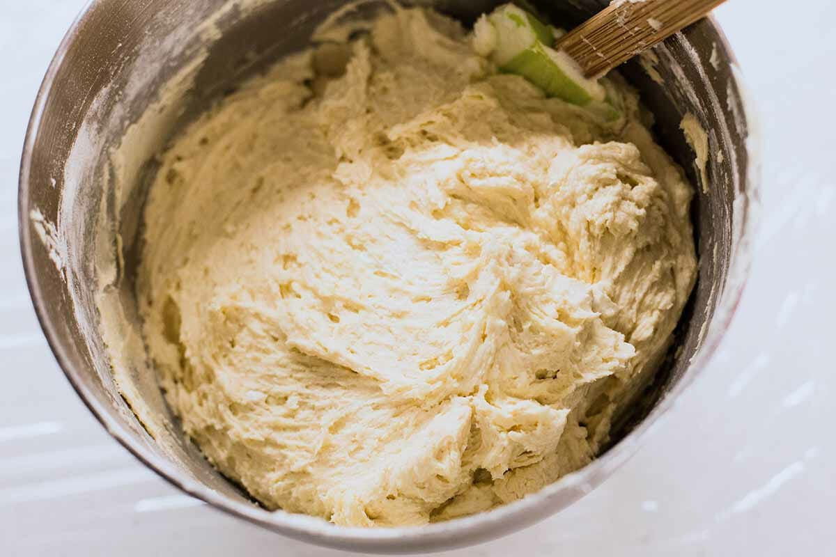 Dough to make homemade sugar cookies in a mixing bowl.