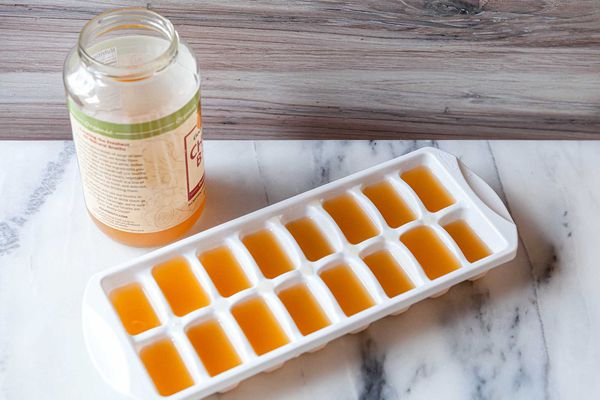 Freeze excess chicken broth in ice cube trays