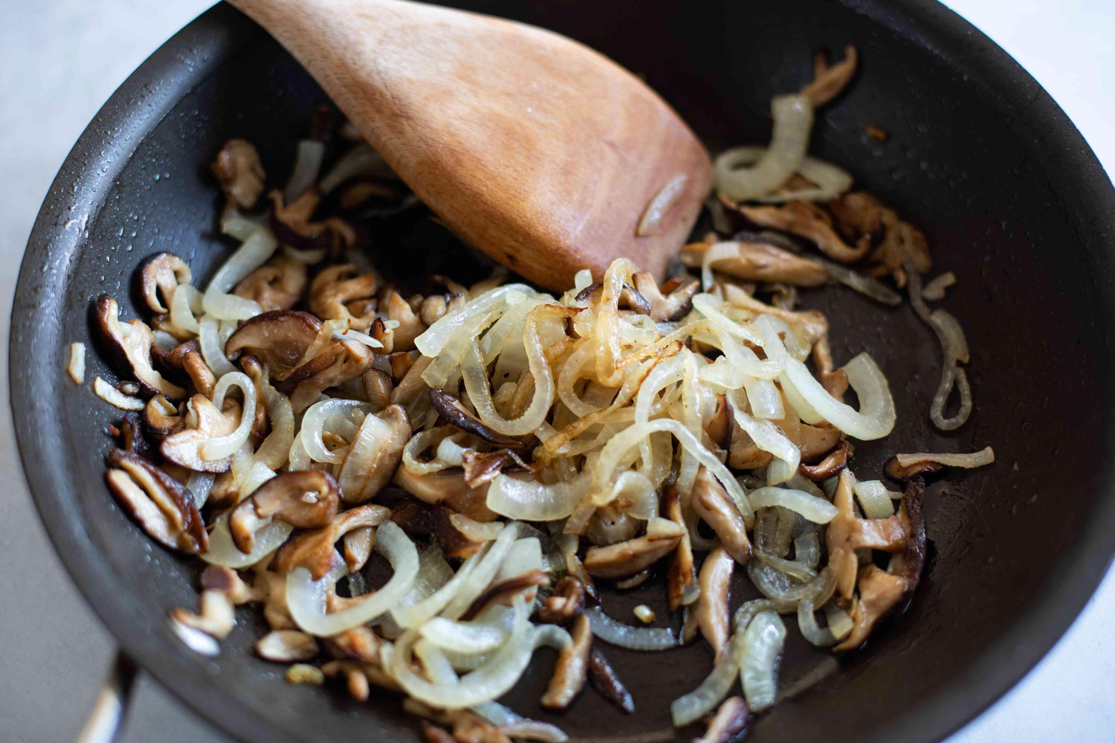 Sauteeing mushrooms for a ground beef and mushroom recipe.