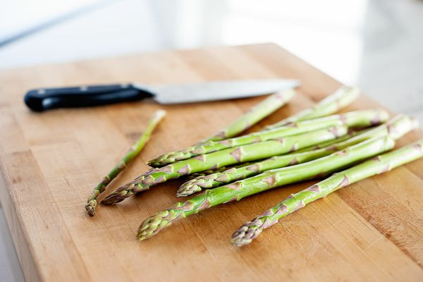 pile of asparagus on cutting board