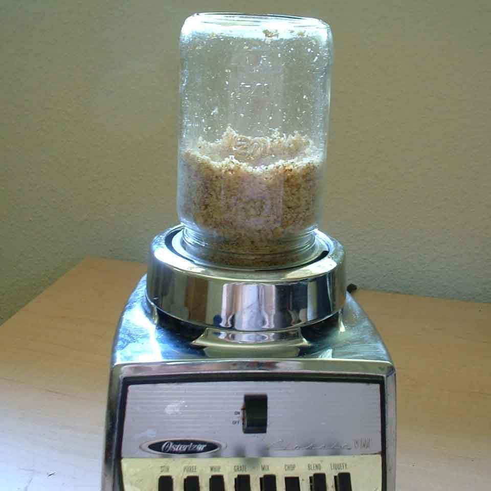 pulse nuts in mason jar in blender to chop