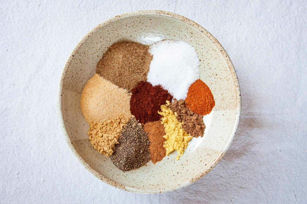 Dry rub for fish - colorful spices in bowl